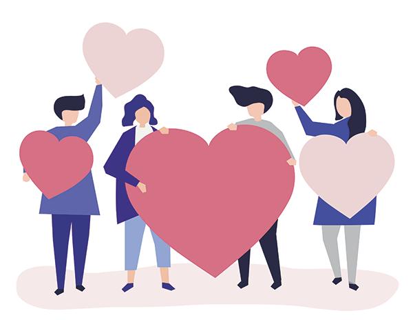 Pessoas abraçando corações cor-de-rosa